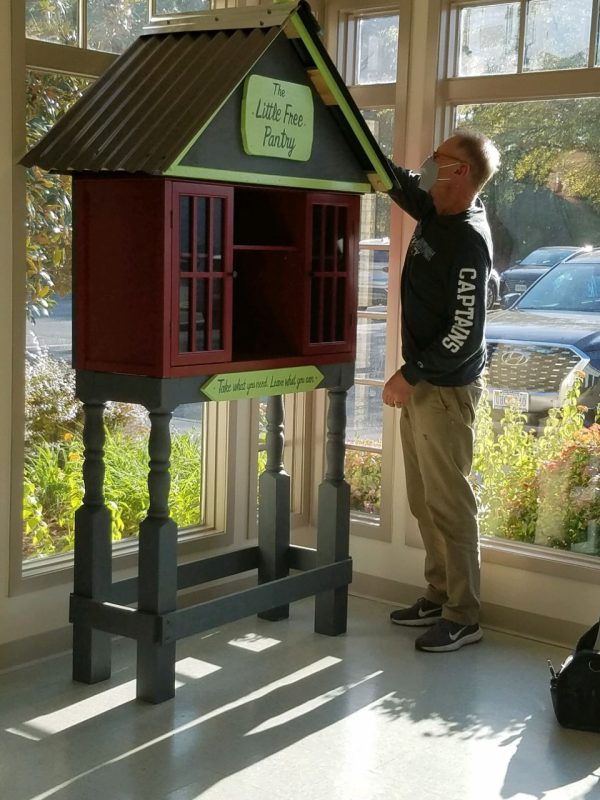 Bill Westbrook installs the Little Free Pantry